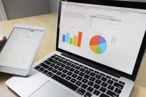 A tablet and laptop illustrating Excel Training Visualise Data with Charts and Spreadsheet Modelling
